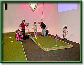 Contestants practice putts on a beautiful Putters Edge surface.